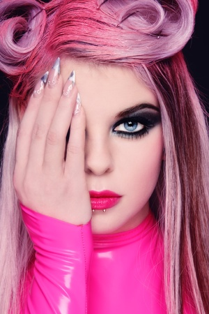 Close-up portrait of young beautiful freaky girl with fancy hairstyle and stylish makeup Stock Photo - 9026752