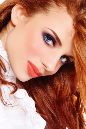 Portrait of young beautiful redhead girl with stylish make-up