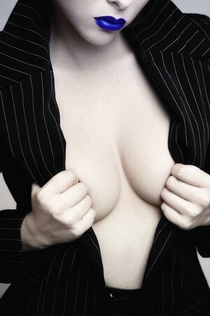 Glamorous shot of sexy woman torso in stylish black jacket