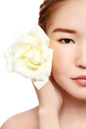 radiant: Close-up portrait of young beautiful asian girl with rose on white background