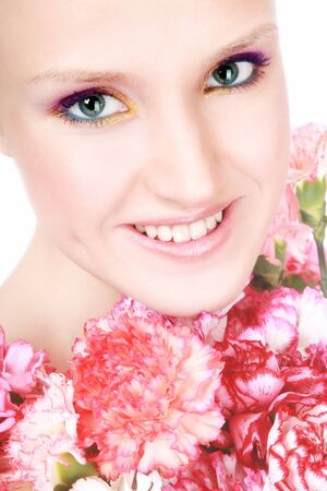 Close-up portrait of young beautiful happy smiling woman with flowers photo