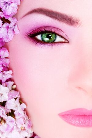 Close-up shot of beautiful womans face with bright makeup photo