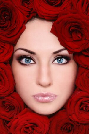 Close-up shot of young beautiful woman face with red roses around Stock Photo - 9187402