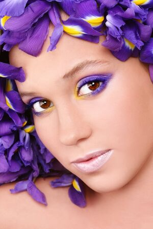 Portrait of young beautiful fresh girl with stylish make-up and irises around her face, selective focus Stock Photo - 9298185