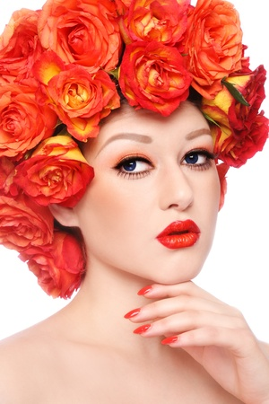 Young beautiful sexy girl with stylish orange make-up and colorful flowers around her face photo