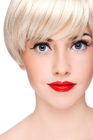 allure: Close-up portrait of young beautiful blond girl with stylish make-up, on white background