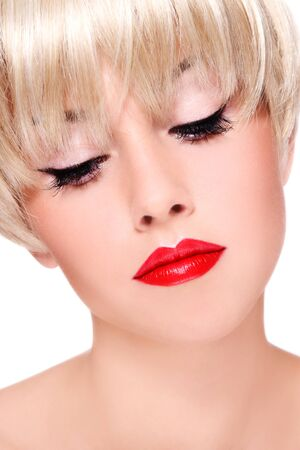Close-up portrait of young beautiful blond woman with red lipstick photo