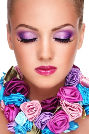 Close-up portrait of young beautiful blond girl with closed eyes and stylish violet make-up Stock Photo