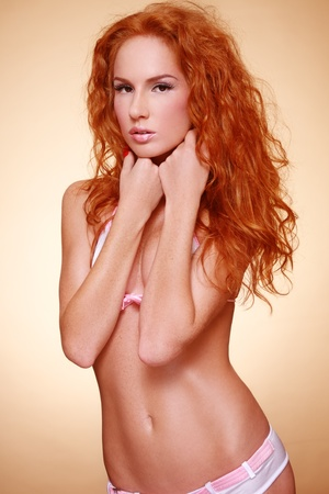 redhead: Beautiful slim tanned sexy redhead girl in bikini Stock Photo