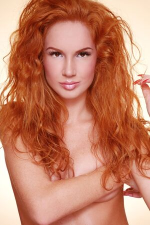 Portrait of young beautiful sexy woman with fiery red curly hair Stock Photo - 9448529