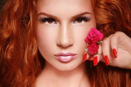 Close-up portrait of young beautiful redhead woman with stylish make-up photo
