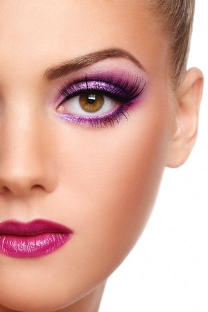 Close-up shot of beautiful woman face with stylish violet make-up photo