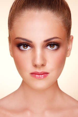Close-up portrait of young beautiful tanned girl with stylish make-up Stock Photo - 9448511