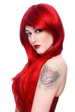 Portrait of young beautiful girl with long red hair and fancy make-up, on white background photo