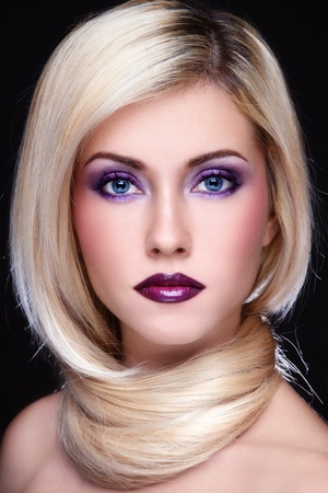 Portrait of young beautiful blond woman with stylish violet make-up photo