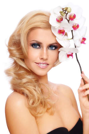 Portrait of young beautiful smiling blond girl with orchid on white background Stock Photo - 9579840