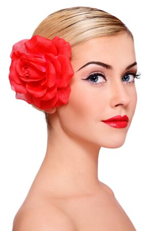 Portrait of young beautiful blond girl with red flower in hair on white background Stock Photo - 9579790