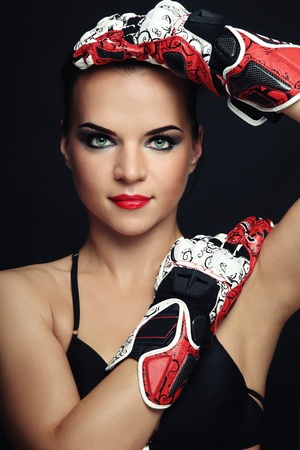Beautiful sexy woman with stylish makeup in biker gloves photo