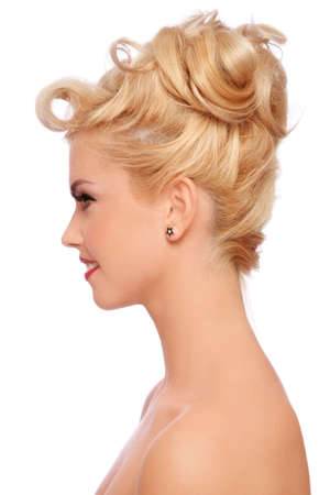Profile portrait of young beautiful sexy blonde with stylish hairdo on white background Stock Photo - 9646562