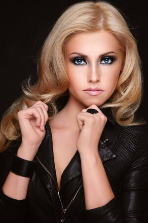 nude blond girl: Young beautiful sexy blond girl in black leather jacket