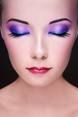 Close-up portrait of young beautiful asian girl with bright fancy make-up photo