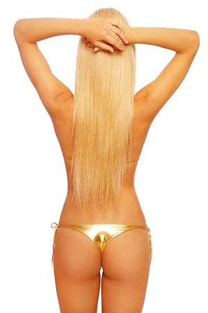 Back of tanned slim sexy blond woman in golden bikini, on white background