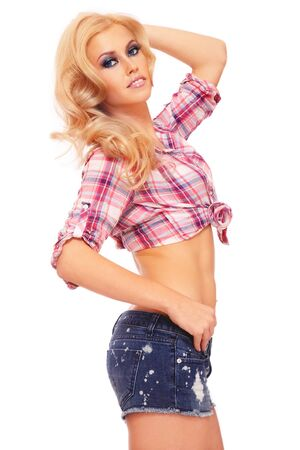 Young beautiful sexy blond girl in casual outfit on white background Stock Photo