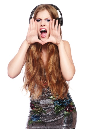 Beautiful stylish excited happy teen girl in headphones singing or crying, on white background Stock Photo - 10064962