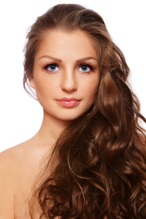 haircurlers: Portrait of young beautiful woman with healthy curly long hair, on white background