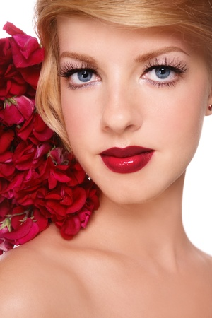 Close-up portrait of young beautiful girl with stylish make-up and colorful flowers on her hair Stock Photo - 10385930
