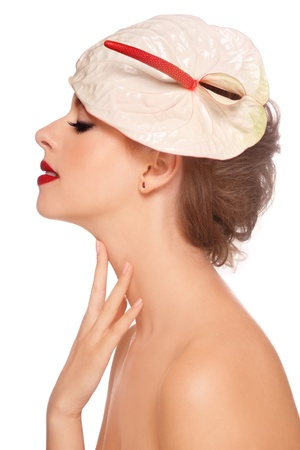Profile portrait of young beautiful woman with stylish make-uo and fancy hat, on white background photo