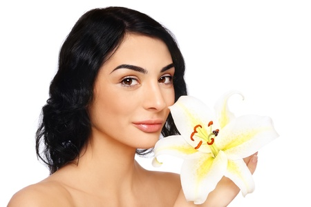 Beautiful smiling woman with lily on white background photo