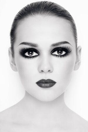 Duotone portrait of beautiful young woman with stylish trendy make-up  Stock Photo