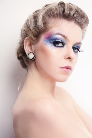 Beautiful young woman with stylish hairdo and fancy make-up