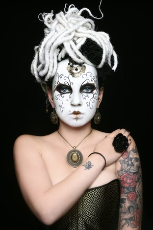 Portrait of woman with venetian mask painted on her face photo