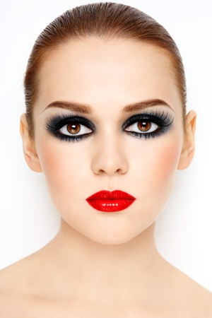 Beautiful young woman with stylish trendy make-up  photo