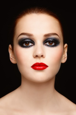 Glamorous portrait of young beautiful woman with stylish make-up  photo