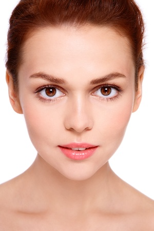 Close-up portrait of young beautiful woman with clear make-up on white background photo