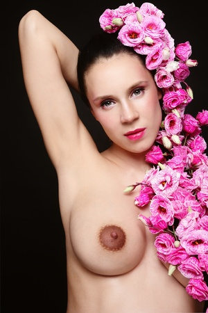 Young attractive naked pregnant woman with pink flowers in her hair Stock Photo - 10697127