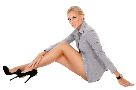 varicose veins: Young beautiful slim sexy blond woman in striped shirt and stilettos sitting on white background