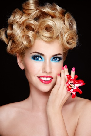 cosmetology: Portrait of young beautiful blond woman with fancy make-up and hairstyle Stock Photo