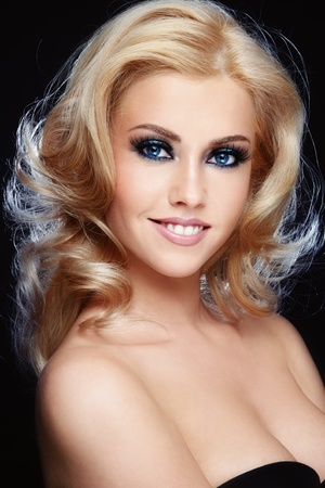 bleached: Young beautiful smiling woman with curly blond hair and stylish make-up