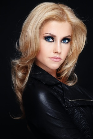 Young beautiful stylish blond woman in leather jacket Stock Photo