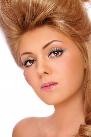 Close-up portrait of young beautiful girl with stylish make-up and hairdo, on white background photo