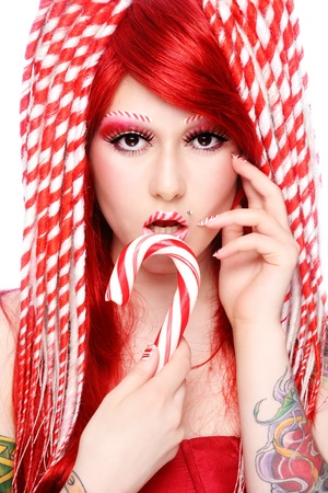 Beautiful young freaky girl with fancy make-up and hairdo photo