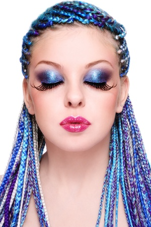 braids: Portrait of young beautiful girl with fancy blue hairstyle and extra long fake eyelashes, on white background Stock Photo