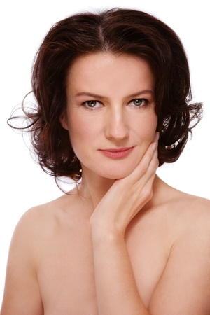 groomed: Portrait of attractive groomed healthy middle-aged woman touching her face, on white background