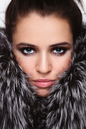 Close-up portrait of young beautiful woman with stylish make-up and fur around her face Stock Photo - 11082781