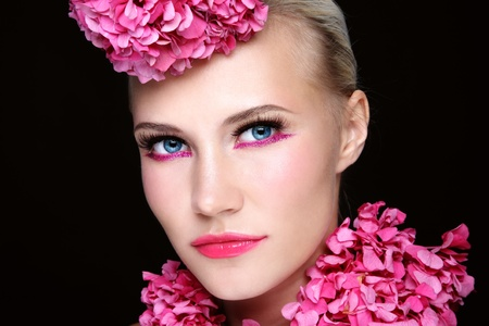 Close-up portrait of young beautiful girl with stylish sparkly pink make-up and flowers on her head and neck Stock Photo - 11082725