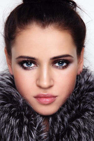 Close-up portrait of young beautiful woman with stylish make-up and fur around her face Stock Photo - 11260908